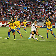 U.S. forward Alex Morgan (13) kicks the ball against Brazil defender Calandrini (3) during a women's soccer International friendly match between Brazil and the United States National Team, at the Florida Citrus Bowl  on Sunday, November 10, 2013 in Orlando, Florida. The U.S won the game by a score of 4-1.  (AP Photo/Alex Menendez)