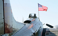 Montgomery, New York - An American flag flies on a B-17 Flying Fortress bomber at Orange County Airport on Oct. 2, 2010. Three World War II planes from the Collings Foundation wereon display and available for tours and flights at Orange County Airport on Oct. 2, 2010.