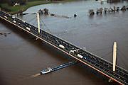 Nederland, Gelderland, Ewijk, 10-01-2011;.Waal ter hoogte van Ewijk, Waalbrug met autoverkeer van de A50. The river Waal and the roadway A50 on the Waalbrug (Waal bridge)..luchtfoto (toeslag), aerial photo (additional fee required).foto/photo Siebe Swart