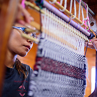 042815       Cable Hoover<br /> <br /> Wilsonya Clay gets a helping hand from her instructor during a weaving class at Navajo Technical University in Crownpoint Tuesday.