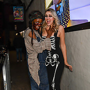 Larissa Eddie BBC Tv judge scares as a sexy skeleton fright by a zombie at The London Bridge Experience & London Tombs on 28 October 2018, London, UK.