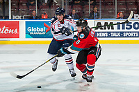 KELOWNA, BC - OCTOBER 2:  Marc Lajoie #28 of the Tri-City Americans stick checks Mark Liwiski #9 of the Kelowna Rockets during first period at Prospera Place on October 2, 2019 in Kelowna, Canada. (Photo by Marissa Baecker/Shoot the Breeze)