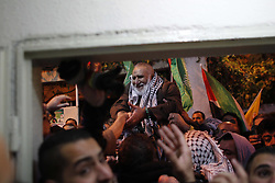 60876252<br /> Released Palestinian prisoner Mahmoud Mohammed Nofal Daajna (C) is welcomed upon his arrival at Shuafat refugee camp in East Jerusalem, Dec. 31, 2013. Israel freed 26 Palestinian prisoners as part of a U.S.-brokered agreement to resume direct peace talks between the two sides, Tuesday, 31st December 2013. Picture by  imago / i-Images<br /> UK ONLY