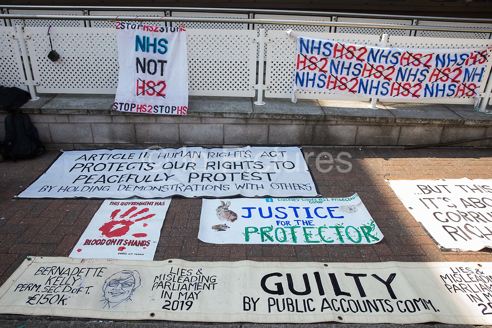 Banners brought by environmental activists from HS2 Rebellion to show support outside High Wycombe Magistrates' Court for seven activists attending hearings are pictured on 10th August 2020 in High Wycombe, United Kingdom. The activists, who are predominantly teenage and who are opposed to the controversial HS2 high-speed rail link, had been arrested whilst standing on a bridge on a public footpath in Denham Country Park by police officers using the Trade Union and Labour Relations Act.