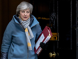 """© Licensed to London News Pictures. 13/03/2019. London, UK. Prime Minister Theresa May leaves 10 Downing Street on her way to Parliament for Prime Minister's Questions. MPs will vote on whether to remove the option of a """"no deal"""" departure from the EU today, after Prine Minister Theresa May's proposed deal was defeated for a second time last night. Photo credit: Rob Pinney/LNP"""