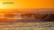 Incoming surf waves at sunrise near Poipu in Kauai, Hawaii, USA