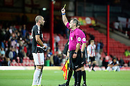 Nottingham Forest midfielder Pajtim Kasami (22) is shown a yellow card, booked after the final whistle during the EFL Sky Bet Championship match between Brentford and Nottingham Forest at Griffin Park, London, England on 16 August 2016. Photo by Matthew Redman.