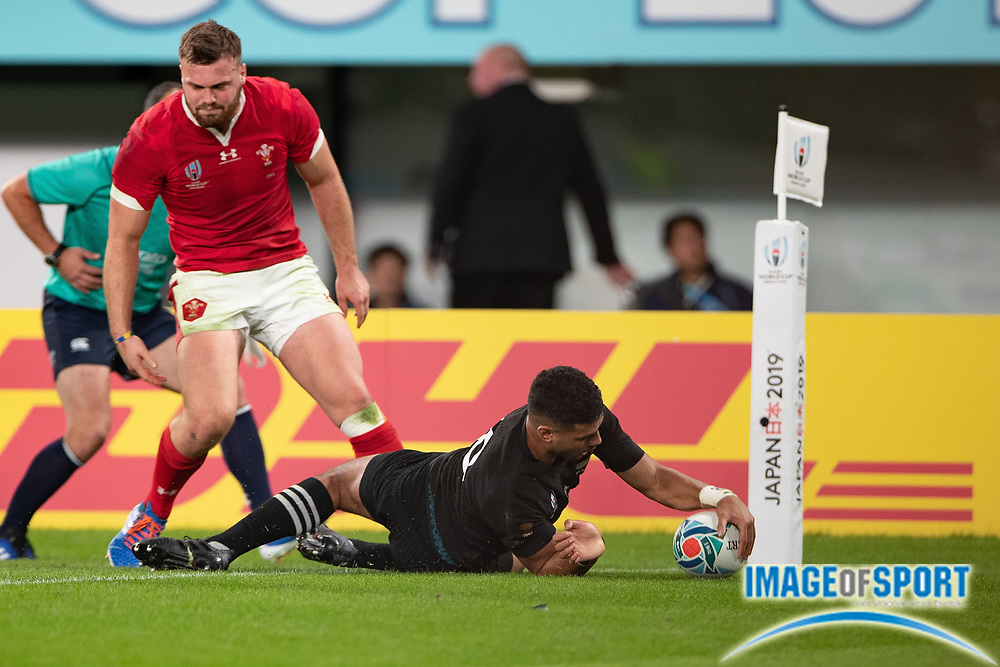 Richie Mo'unga of New Zealand scores a try during the Rugby World Cup bronze final match between New Zealand and Wales,  Friday, Nov, 1, 2019, in Tokyo. New Zealand defeated Wales 40-17. ( Flor Tan Jun/Espa-Images-Image of Sport)