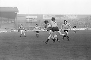 Dublin tackles Kerry from behind during the All Ireland Senior Gaelic Football Semi Final, Dublin v Kerry in Croke Park on the 23rd of January 1977. Dublin 3-12 Kerry 1-13.