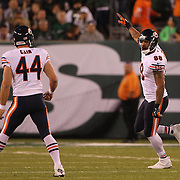 Chicago Bears Dante Rosario, (right), celebrates a turnover during the New York Jets Vs Chicago Bears, NFL regular season game at MetLife Stadium, East Rutherford, NJ, USA. 22nd September 2014. Photo Tim Clayton for the New York Times