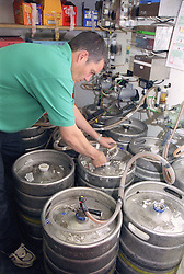 Man with disability checking beer barrels in leisure centre,