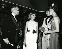 1979 Bill Welsh chats with Mia Farrow at the premiere of Hurricane at Mann's Chinese Theater