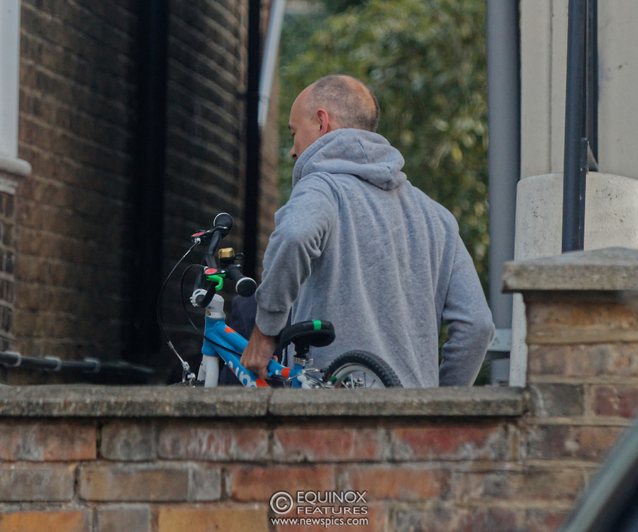 PICTURE EXCLUSIVE - SPECIAL FEES APPLY - CALL BEFORE USE<br /> London, United Kingdom - 8 September 2019<br /> Dominic Cummings looks startled to be spotted arriving back at his north London home on Sunday after a day out with his wife, Mary Wakefield, his son and some friends. Despite clutching a new child's bicycle and fussing over his young son, at times he seemed lost in his thoughts as he tried to focus on his family rather than the dramatic and explosive week in Westminster politics. As Boris Johnson's special political advisor, the former campaign director of Vote Leave has this week found himself at the centre of controversy and harsh criticism from MPs over the handling of the sacking of twenty one rebel Conservative MPs.<br /> EXCLUSIVE PICTURES - MANDATORY BYLINE: EQUINOXFEATURES.COM - A charge is made for each use of each picture in each format on each platform in each territory.<br /> (photo by: EQUINOXFEATURES.COM)<br /> Picture Data:<br /> Photographer: Equinox Features<br /> Copyright: ©2019 Equinox Licensing Ltd. +443700 780000<br /> Contact: Equinox Features<br /> Date Taken: 20190908<br /> Time Taken: 18494521<br /> www.newspics.com