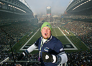 Seattle Seahawks fan and Blue Thunder drum band asst. director Mike Roling celebrates the first touchdown against the San Francisco 49ers. (AP Photo/John Froschauer)