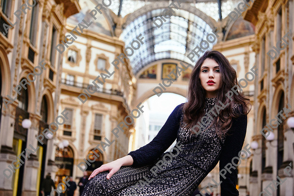 Milan, Italy - January 30, 2020 Body Portrait of a Female Model with the interior of Galleria Vittorio Emanuele II in the background during the day