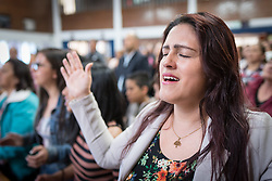 18 November 2018, Bogotá, Colombia: Pastors-wife Olga prays during Sunday service. The church of San Lucas ('Saint Lucas') of the Evangelical Lutheran Church of Colombia, brings together a congregation of some 100 people in the southern areas of Bogotá. Located in the Kennedy area, the church has recently celebrated 50 years. As part of its ministry, the church runs a school and college, The Colegio Evangelico Luterano de Colombia (CELCO) San Lucas, offering education to just over 1,000 students aged 3-18. The school started as a social initiative offering care for children aged 0-4 in Bogotá's less wealthy neighbourhood, allowing the parents opportunities to go to work. 36 years after its foundation, the school employs 56 staff, of which 36 are teachers.