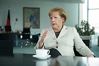 15 AUG 2013, BERLIN/GERMANY:<br /> Angela Merkel, CDU, Bundeskanzlerin, waehrend einem Interview, in ihrem Buero, Bundeskanzleramt<br /> IMAGE: 20130815-01-005<br /> KEYWORDS: Büro
