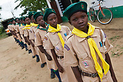 Scouts practice their routine in the grounds of Mari Mani primary school. The Wema Centre has supplied the scouts with all their uniforms, socks and shoes. The school is supported by Wema, a NGO organisation supporting vulnerable children.  The school has 807 pupils and 16 teachers.