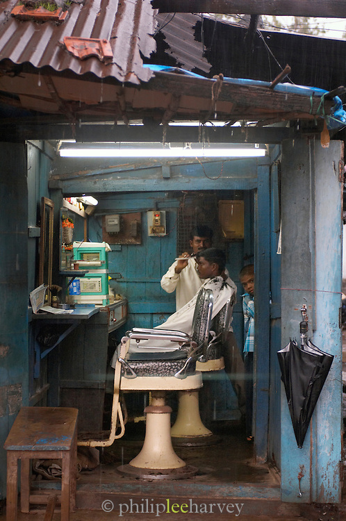 Portrait of a Barber shop during monsoon rains, Goa, India