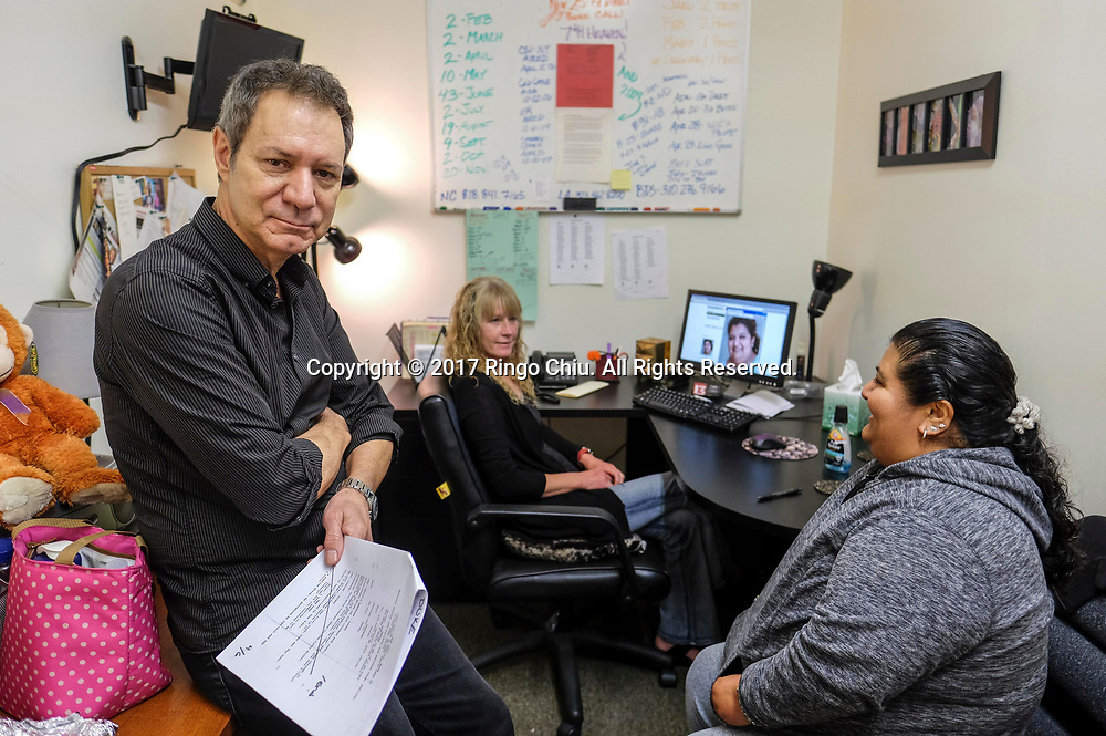 John Paizis, founder and director of Performing Arts Studio West, works wit a client in their studio in Inglewood. Performing Arts Studio West (PASW), is a 19-year-old organization that trains and acts as agent for performers with developmental disabilities, including autism, Down's Syndrome, sometimes in combination with physical disabilities.  (Photo by Ringo Chiu)<br /> <br /> Usage Notes: This content is intended for editorial use only. For other uses, additional clearances may be required.