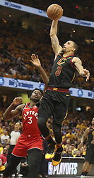 May 7, 2018 - Cleveland, OH, USA - Cleveland Cavaliers' George Hill drives past Toronto Raptors' OG Anunoby during the first quarter of Game 4 of a second-round playoff series on Monday, May 7, 2018 in Cleveland, Ohio. (Credit Image: © Phil Masturzo/TNS via ZUMA Wire)