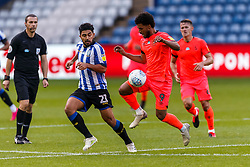 Massimo Luongo of Sheffield Wednesday and Elias Kachunga of Huddersfield Town - Mandatory by-line: Daniel Chesterton/JMP - 24/06/2020 - FOOTBALL - Hillsborough - Sheffield, England - Sheffield Wednesday v Huddersfield Town - Sky Bet Championship