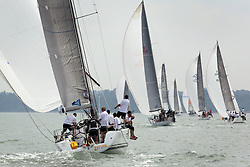 Brewin Dolphin Scottish Series 2014, the start of an International IRC competition racing on the Solent off Cowes and hosted by the RORC.<br /> <br /> Stevie Cowie and Ian Budgen on Team Scotland's, Zephyr, a First 40.<br /> <br /> Credit.  Marc Turner
