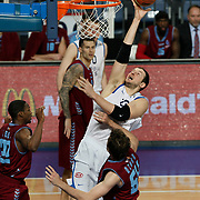 Anadolu Efes's Ermal Kurtoglu (R) during their Turkish Basketball League match Anadolu Efes between Trabzonspor at Sinan Erdem Arena in Istanbul, Turkey, Saturday, December 10, 2011. Photo by TURKPIX