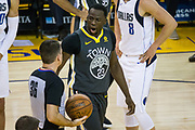 Golden State Warriors forward Draymond Green (23) yells at referee David Jones (36) after being fouled at the rim by the Dallas Mavericks at Oracle Arena in Oakland, California, on February 8, 2018. (Stan Olszewski/Special to S.F. Examiner)