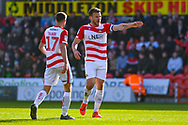 Andrew Butler of Doncaster Rovers (6) chats to Matty Blair of Doncaster Rovers (17) during the EFL Sky Bet League 1 match between Doncaster Rovers and Coventry City at the Keepmoat Stadium, Doncaster, England on 4 May 2019.