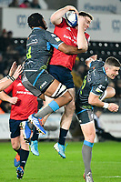 Rugby Union - 2019 / 2020 Champions Cup: Ospreys vs. Munster<br /> <br /> Chris Farrell of Munster  leaps to take the ball from a kick off, at The Liberty Stadium.<br /> <br /> COLORSPORT/WINSTON BYNORTH