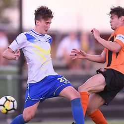 BRISBANE, AUSTRALIA - JANUARY 8: Sebastian Scaroni of Strikers and Matt Richardson of Easts compete for the ball during the Kappa Silver Boot Group A match between Brisbane Strikers and Eastern Suburbs on January 8, 2017 in Brisbane, Australia. (Photo by Patrick Kearney)