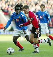 Photograph: Scott Heavey.<br />Southampton v Portsmouth. FA Barclaycard Premiership. 21/12/2003.<br />Marian Pahars takes on Linvoy Primus