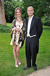 The HON.JUSTIN PORTMAN and NATALIA VODIANOVA at the Raisa Gorbachev Foundation fourth annual fundraising gala dinner held at Stud House, Hampton Court, Surrey on 6th June 2009.
