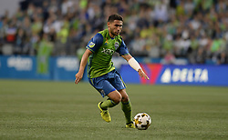 September 27, 2017 - Seattle, WASHINGTON, U.S - Sounders midfielder CHRISTIAN ROLDAN (7) in action against the Vancouver Whitecaps in an MLS match at Century Link Field in Seattle, WA. (Credit Image: © Jeff Halstead via ZUMA Wire)