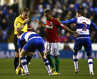 Referee Mike Jonescalms down Reading's Alex Pearce and Swansea City's Wayne Routledge ..Football - Barclays Premiership - Reading v Swansea City - Wednesday 26th December 2012 - Madejski Stadium - Reading..