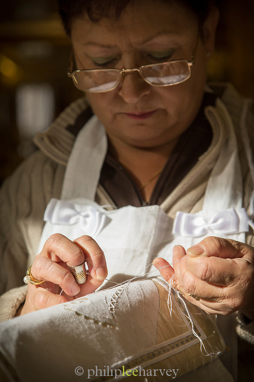 Lady weaving Lace, Burano. Venice, Italy, Europe