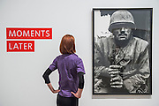 Shell Shocked by Don McCullin. Conflict, Time, Photography, a new exhibition at the Tate Modern - showcasing the unique ways photographers look back at moments of conflict, from the seconds after a bomb is detonated to 100 years after a war has ended. It includes: renowned photographers Don McCullin, Kikuji Kawada and Taryn Simon; Luc Delahaye's large-scale image of the US bombing of Taliban positions in Afghanistan, showing a cloud of smoke rising from the battlefield; Hiromi Tsuchida's large-scale photograph of a watch stopped at the moment the atomic bomb fell on Hiroshima in 1945; The Archive of Modern Conflict's colourful and chaotic new installation, bringing together war-related images and objects from around the world and across the past 100 years; and Chloe Dewe Mathews's haunting landscapes photographed at dawn, showing the places where British soldiers were executed for desertion and cowardice in the First World War. The show runs from 26 November 2014 – 15 March 2015. Tate Modern, London, UK 25 Nov 2014.
