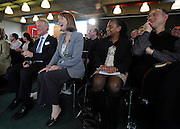 © licensed to London News Pictures. LONDON, UK.  13/06/11. Harriet Harmen laughs during the speech.  Labour Party leader Ed Miliband speak to members of the community and to the media at Coin Street Neighbourhood Centre, South Bank, London. Mr Miliband answered questions that concerned the local community and some challenging questions from the media concerning his relationship with his brother David Miliband Photo credit should read Stephen Simpson/LNP