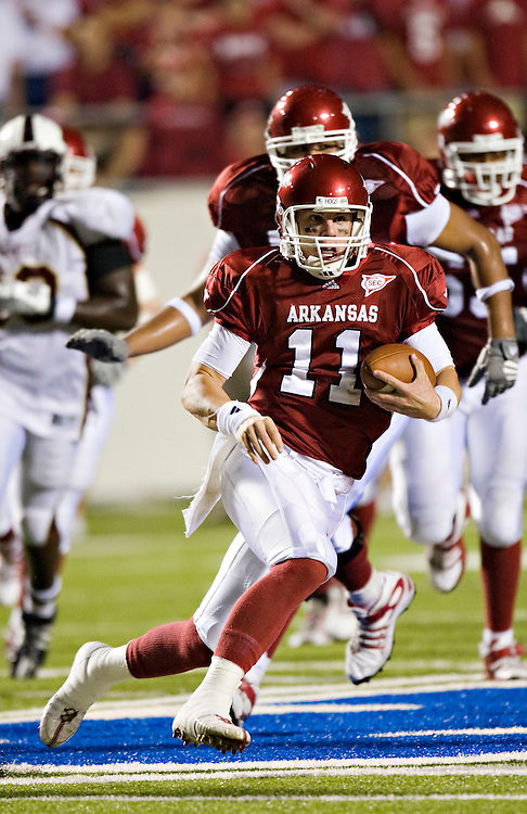 LITTLE ROCK, AR - SEPTEMBER 6:   Casey Dick #11 of the Arkansas Razorbacks runs with the ball against the Louisiana-Monroe Warhawks at War Memorial Stadium on September 6, 2008 in Little Rock, Arkansas.  The Razorbacks defeated the Warhawks 28-27.  (Photo by Wesley Hitt/Getty Images) *** Local Caption *** Casey Dick