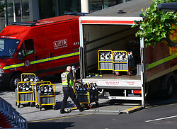 A London Fire Brigade worker moves air tanks close to the scene of a fire that engulfed the 24-storey Grenfell Tower in west London.