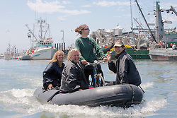 Earthwatch Team On Inflatable With Bicycle