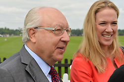 URS SCHWARZENBACH and his daughter at the Cartier Queen's Cup Polo final at Guard's Polo Club, Smiths Lawn, Windsor Great Park, Egham, Surrey on 14th June 2015
