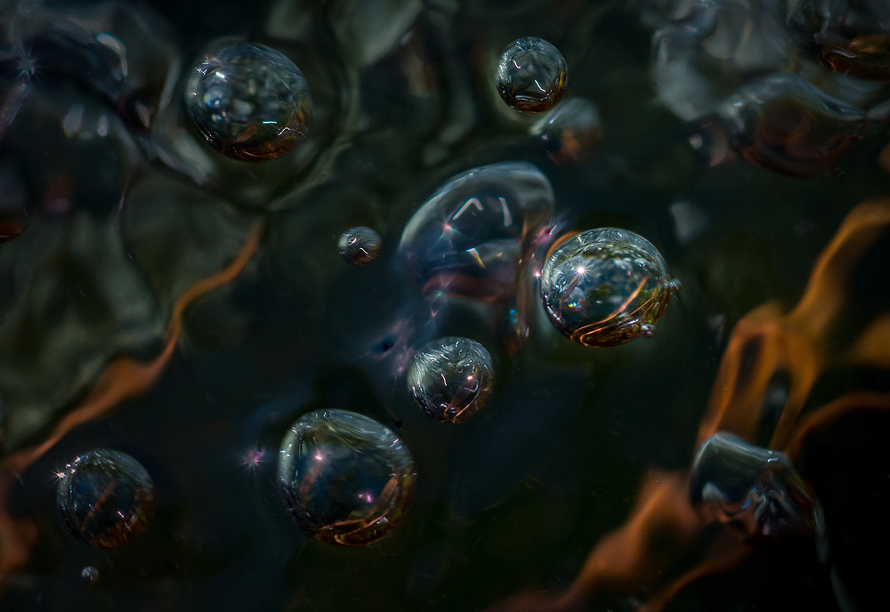 Planetary bubbles in a mountain stream create a wondrous other worldly image.