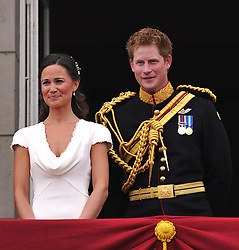 Pippa Middleton and Prince Harry appear on the balcony of Buckingham Palace, London, following the wedding of Prince William and Kate Middleton at Westminster Abbey.