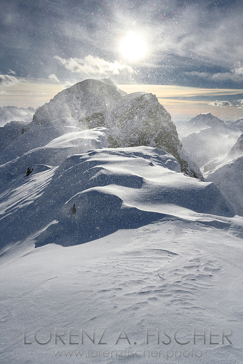 Winddrift and storm on the way up to Piz Lagrev, Julier Pass, Grisons, Switzerland