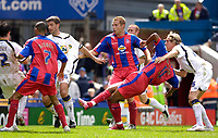 Photo: Daniel Hambury.<br />Crystal Palace v Leeds United. Coca Cola Championship. 13/08/2006.<br />Palace's Clinton Morrison (2nd right) sees his shot squeeze in for the winner.