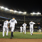 New York Yankees players take the field wearing number 42  during Jackie Robinson Day celebrations during the New York Yankees V Chicago Cubs, double header game two at Yankee Stadium, The Bronx, New York. 16th April 2014. Photo Tim Clayton