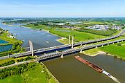 Nederland, Gelderland, Zaltbommel, 13-05-2019; bruggen over de rivier de Waal bij Zaltbommel. Naast de spoorbrug, spoorlijn Utrecht - Den Bosch, de Martinus Nijhofbrug voor autoverkeer op rijksweg A2. Intercity trein verlaat de spoorbrug.<br /> Bridges over the River Waal. Railway bridge, railway line Utrecht - Den Bosch and the Martinus Nijhof bridge, motorway A2.<br /> aerial photo (additional fee required); luchtfoto (toeslag op standard tarieven); copyright foto/photo Siebe Swart