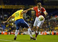 Photo: Ed Godden.<br /> Brazil v Wales. International Friendly. 05/09/2006.<br /> Elano (L) challenges Wales's Craig Bellamy.